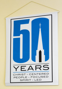 The 50th year banner and it's designer, ?. He is the grandson on Carolyn Bough